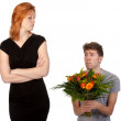 Young boy offering a bunch of flowers to his angry girlfriend — Stock Photo