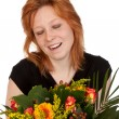 Stock Photo: Happy and surprised young womwith beautiful bunch of flower
