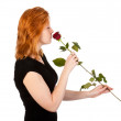 Beautiful redhead woman with rose, isolated on white — Stock Photo