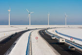 Dutch rural winter landscape with a highway and big windturbines — Stock Photo
