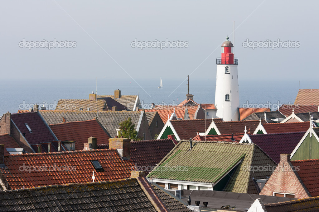Aerial view at the lighthouse and roofs of a old characteristic fishing village in the Netherlands — Stock Photo #9086174