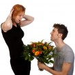 Young man offers his surprised girlfriend a large bouquet of flo — Stock Photo
