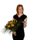 Woman is wondering who sent her flowers? — Stock Photo