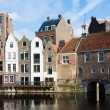 Stock Photo: Historic cityscape along channel in Delfshaven, district of