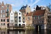 Historic cityscape along a channel in Delfshaven, a district of — Stok fotoğraf