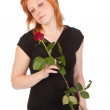 Beautiful redhead woman with rose, isolated on white — Stock Photo #9785124