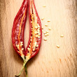 Royalty-Free Stock Photo: Red hot chili peppers on the wooden board