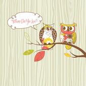 Two pretty owls sitting on the branch. — Stock Vector