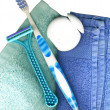 Toothbrush, with floss and towels - Stock Photo