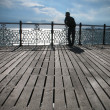 Stock Photo: A young man looking into the distance, coast, Brighton, Pier