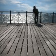 A young man looking into the distance, coast, Brighton, Pier - Stock Photo