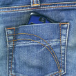 Pocket with mobile phone - Stock Photo