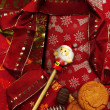 Red Christmas background made of wrapping Paper,cookies,Chocolate and Santa — Stock Photo