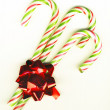 Candy canes with a bow — Stock Photo