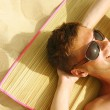 Man Sunbathing on the beach — Stock Photo #8100776