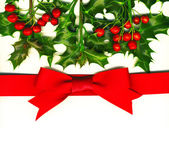 Christmas card with holly and red bow — Stock Photo