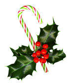 Candy cane with pretty holly leaves and berries — Stock Photo