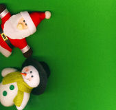 Santa Claus and snowman on the green background — Stock Photo