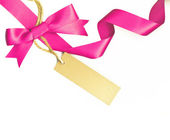 Pink ribbon with a label isolated on white — Foto Stock