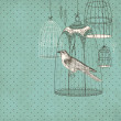 Vintage card with a bird in the cage — Stock Photo
