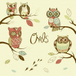 Owls, trendy card with owls sitting on the brunches - Stock Photo