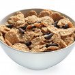 Bowl of bran cereal with chocolate curls — Stock Photo