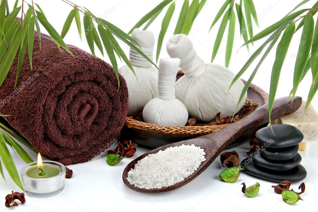 Spa massage setting with a fluffy towel, thai herbal compress massage balls, natural soap bars, bath salt and bamboo — Photo #8625071