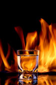 Fire water, strong alcoholic drink concept — Stock Photo