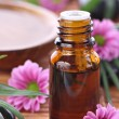 Aromatherapy bottle with pink flowers — Stock Photo