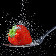 Strawberry with granulated sugar - Stock Photo