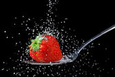 Strawberry with granulated sugar — Stock Photo