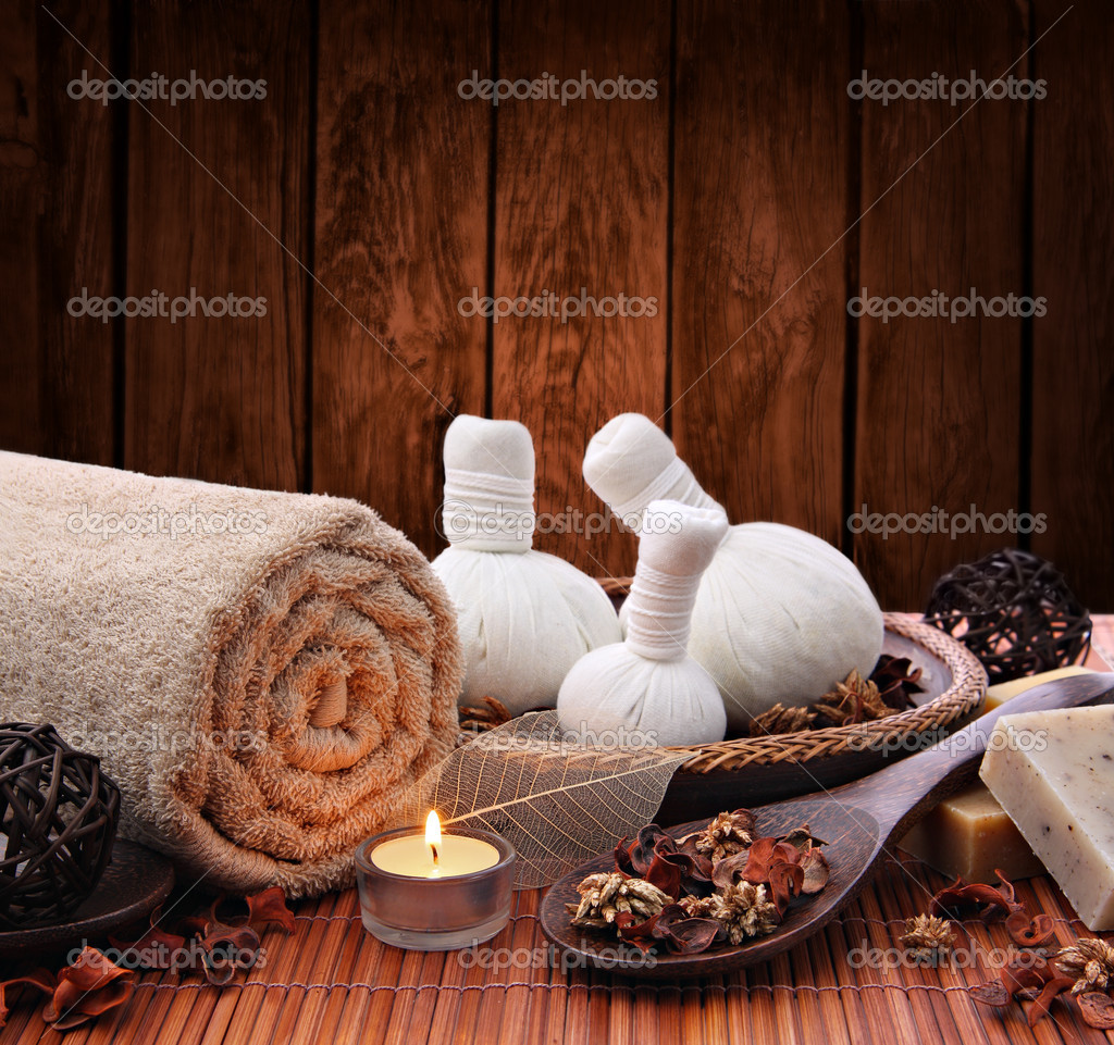 Spa massage setting with thai herbal compress stamps and candlelight — Stock Photo #8991013