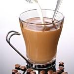 Milk poured into coffee — Stock Photo #9236598