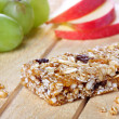 Healty eating concept with cereal bar - Stock Photo