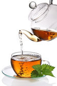 Tea poured into cup — Stock Photo