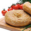 Fresh bagels, tomatoes and chives - Stock Photo