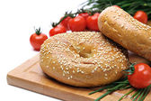 Fresh bagels, tomatoes and chives — Stock Photo