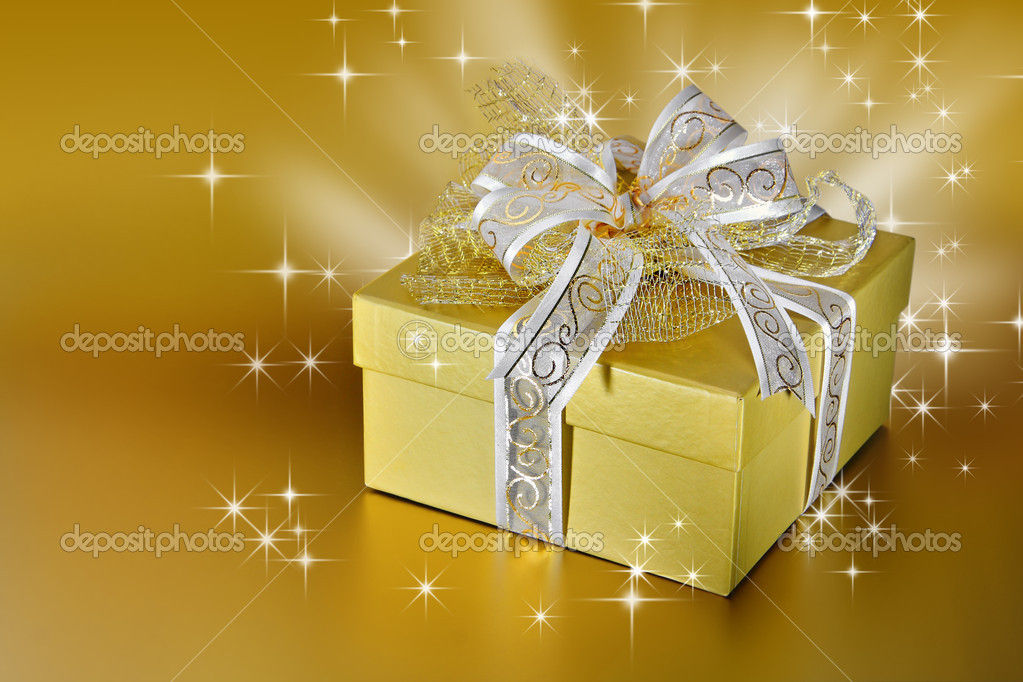 Golden gift box or present with ribbon and bow — Stock Photo #9616651