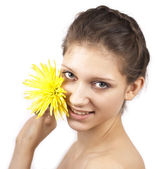 Young beautiful woman with yellow flower — Stock Photo