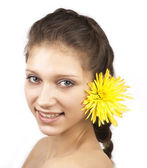 Portrait of young attractive woman with yellow flower isolated — Stock Photo