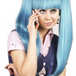 Pretty woman with blue hair talking on mobile phone - Stock Photo