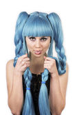 Expressive woman with her tongue out in blue wig — Stock Photo
