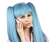 Lovely woman with blue hair talking on mobile phone — Stock Photo