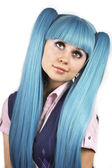 Pretty woman with blue hair looking up — Stock Photo