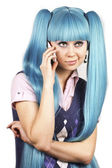 Pretty woman with blue hair talking on mobile phone — Stock Photo