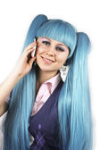 Cute smiling woman with blue hair talking on mobile phone — Stock Photo