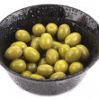 Bowl of green olives isolated on white - Stock Photo