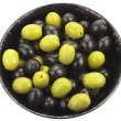 Green and black olives in bowl  isolated on white - Stock Photo