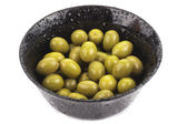 Bowl of green olives isolated on white — Stock Photo