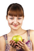 Young smiling woman holding green apple — Stock Photo
